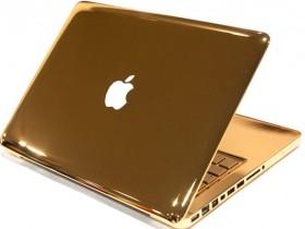 золотой компьютер MacBook Pro