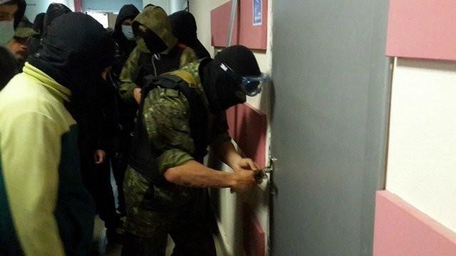 В Одессе депутаты и неизвестные в масках атакуют админздания