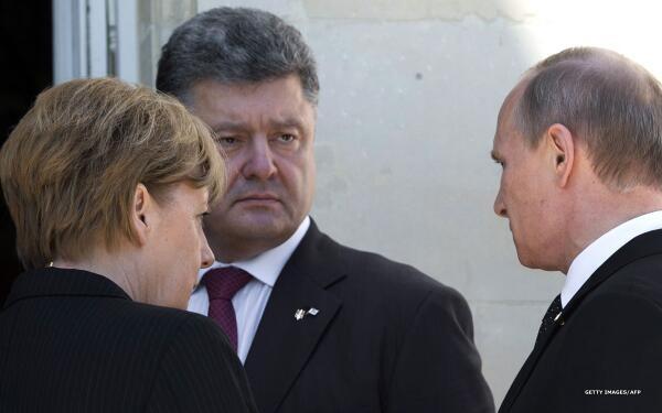 В интернете возникли фото «теплой» встречи Порошенко и Путина