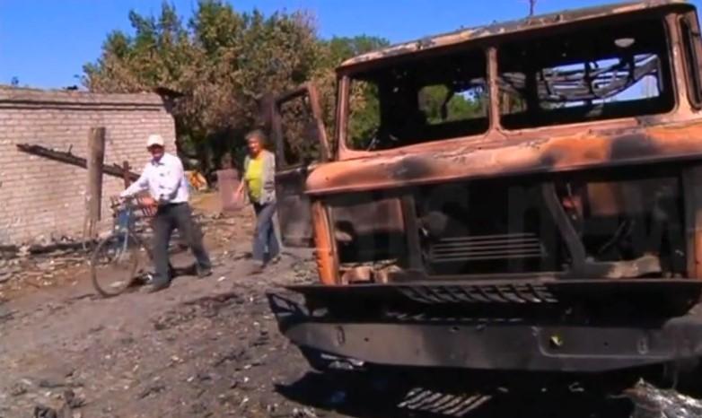 ФОТО: Жизнь Иловайска в ДНР: руины, пепел, очереди за хлебом