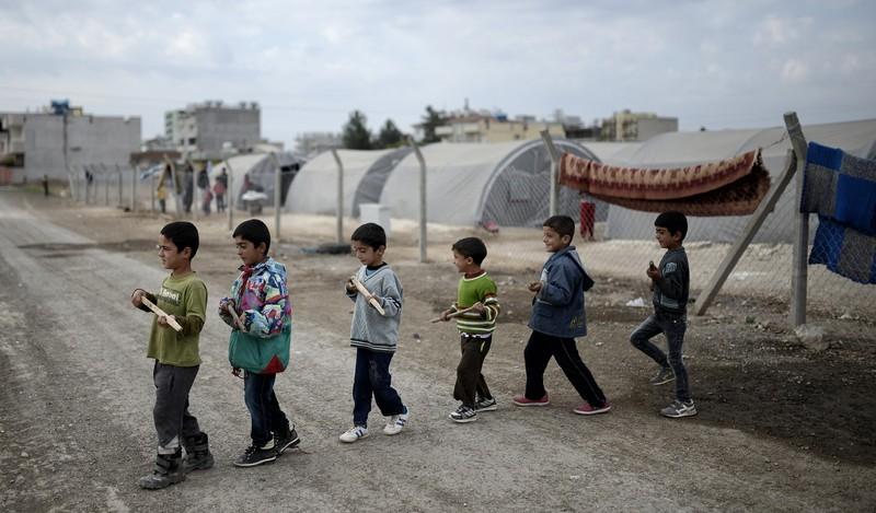 ФОТО: Как ИГИЛ завербовывает молодых смертников в Сирии