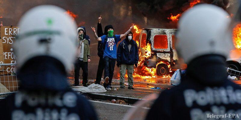 Брюссель обхватили волнения: протестующие жгут авто (ФОТО)
