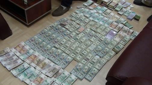 Террористы в Мелитополе меняли меченые гривны на валюту